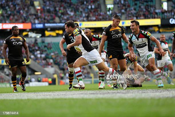 Karl Dickson of Harlequins scores a try during the Aviva Premiership match between London Wasps and Harlequins at Twickenham Stadium on September 7...