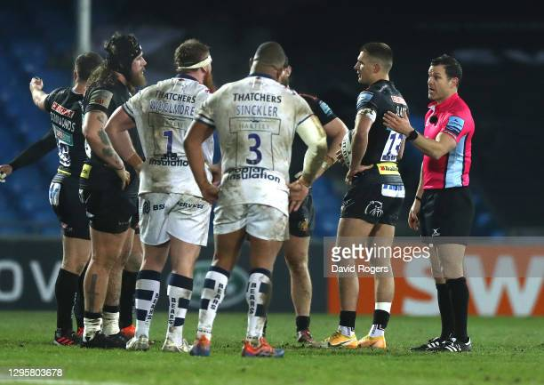 Karl Dickson, the referee talks to Bristol Bears props Kyle Sinckler and Jake Woolmore and Exeter Chiefs prop Harry Williams during the Gallagher...