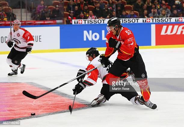 Karl Fabricius of Lulea Hockey battles with Erik Gustafsson of Frolunda Gothenburg during the Champions Hockey League Final match between Lulea...