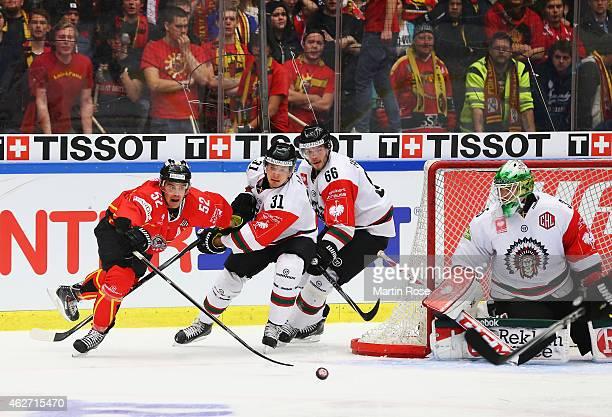 Karl Fabricius of Lulea Hockey is challenged by Niklas Lasu and Oscar Fantenberg of Frolunda Gothenburg during the Champions Hockey League Final...
