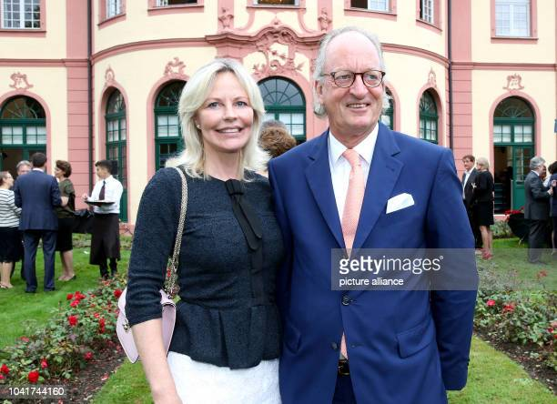 Karl Friedrich Prince of Hohenzollern and his wife Katharina Princess of Hohenzollern posing during a reception on the evening before the 80th...