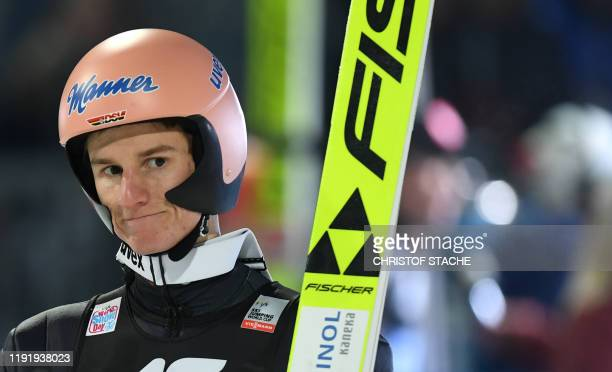 Karl Geiger from Germany reacts after his qualification jump at the fourth stage of the Four Hills Ski Jumping tournament in Bischofshofen, Austria,...