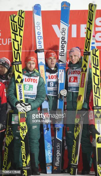 Karl Geiger Markus Eisenbichler and Stephan Leyhe from Germany are seen celebrating after winning the team competition of the FIS Ski Jumping World...