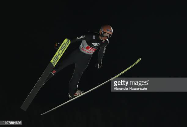 Karl Geiger of Germany competes during the first round during the 68th FIS Nordic World Cup Four Hills Tournament at Paul-Ausserleitner-Schanze on...