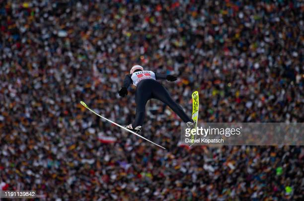 Karl Geiger of Germany competes during the first round of the 68th FIS Nordic World Cup Four Hills Tournament at Olympiaschanze on January 1 2020 in...