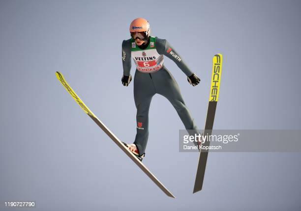 Karl Geiger of Germany competes during the trail round of the 68th FIS Nordic World Cup Four Hills Tournament at Schattenbergschanze on December 29...