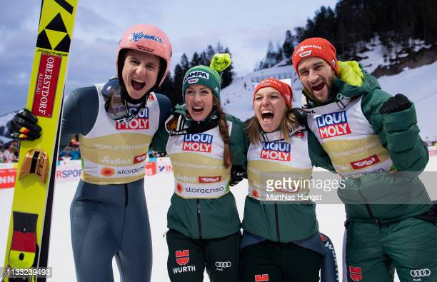 Karl Geiger of Germany Katharina Althaus of Germany Markus Eisenbichler of Germany and Juliane Seyfarth of Germany celebrate following their victory...