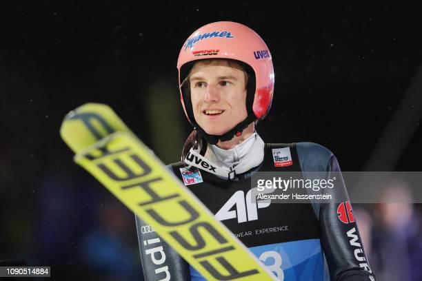 Karl Geiger of Germany reacts after his jump during the final round on day 8 of the 67th FIS Nordic World Cup Four Hills Tournament ski jumping event...