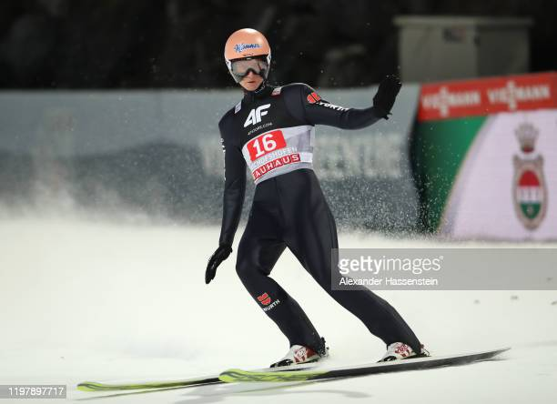 Karl Geiger of Germany reacts after his second jump during the 68th FIS Nordic World Cup Four Hills Tournament at PaulAusserleitnerSchanze on January...
