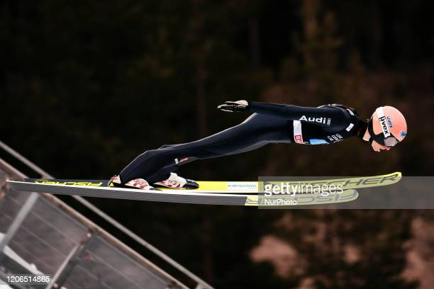 Karl Geiger soars in the air during the trial round of the men's large hill team competition HS130 of the FIS Ski Jumping World Cup in Lahti,...