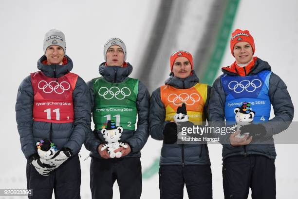 Karl Geiger Stephan Leyhe Richard Freitag and Andreas Wellinger of Germany celebrate their silver medal on the podium during the Ski Jumping Men's...