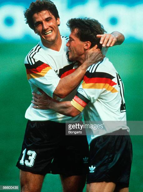 Karl Heinz Riedle and Lothar Matthaeus of Germany celebrates the first goal during the World Cup quarter final match between Germany and...