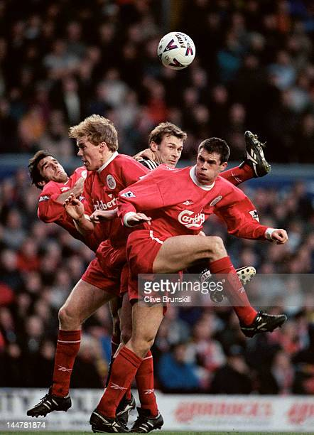 Karl Heinz Riedle Steve Staunton and Jamie Carragher of Liverpool rise to deny the ball to Duncan Ferguson of Newcastle United on 28th December 1998...
