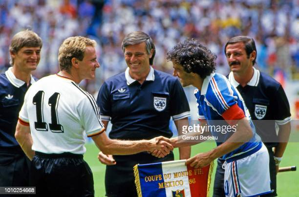 Karl Heinz Rumenigge captain of West Germany FRG and Michel Platini captain of France during the World Cup semi final match between West Germany FRG...