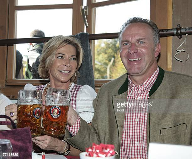 Karl Heinz Rummenigge and wife Martina arrive at the Kaefers party tent for a day at the Oktoberfest on September 30 2007 in Munich Germany