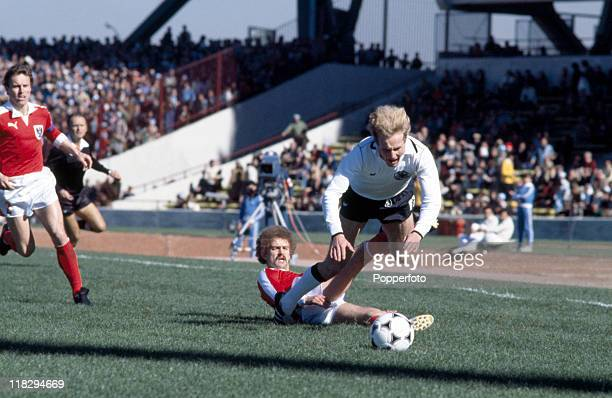 Karl Heinz Rummenigge of West Germany is tackled by Herbert Prohaska of Austria during their World cup match in Cordoba Argentina on 21st June 1978...