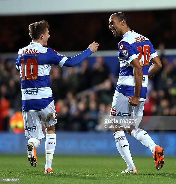 Karl Henry of QPR celebrates after scoring the second goal of the game with team mate Tom Carroll during the Sky Bet Championship match between...