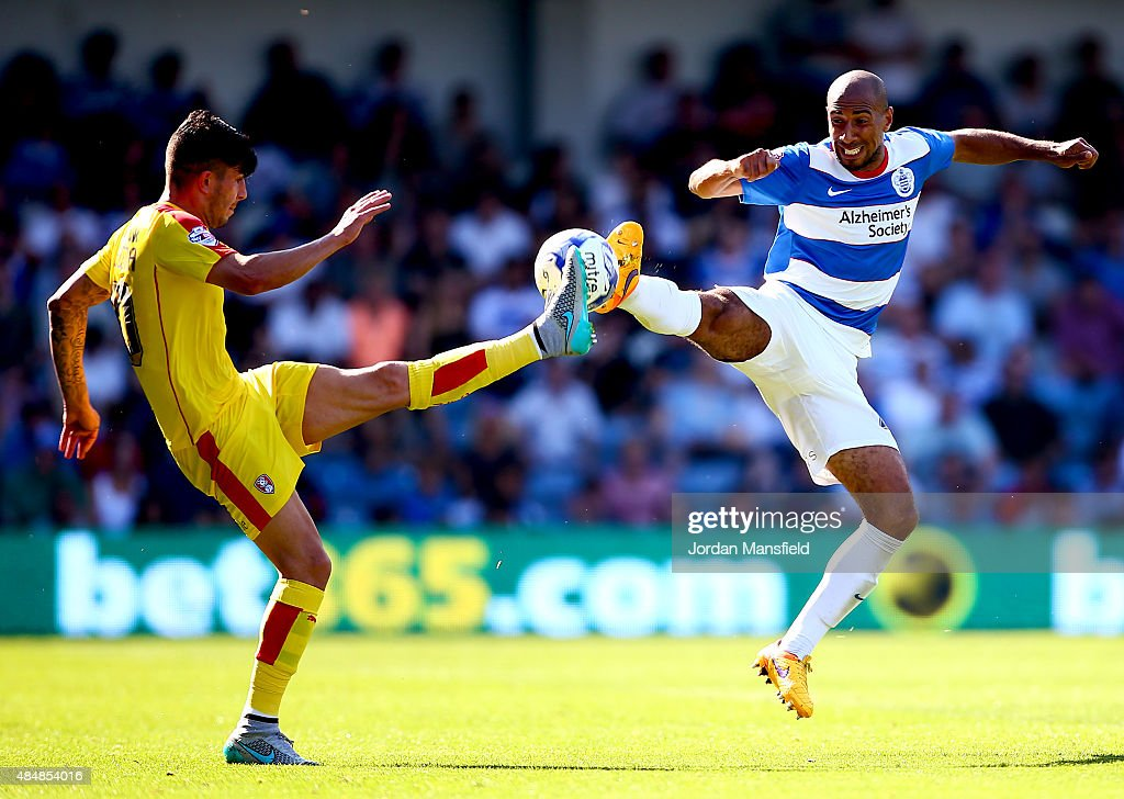 Karl Henry of QPR goes in for a challenge with Emmanuel Ledesma of Rotherham during the Sky Bet Championship match between Queens Park Rangers and Rotherham United at Loftus Road on August 22, 2015 in London, England.