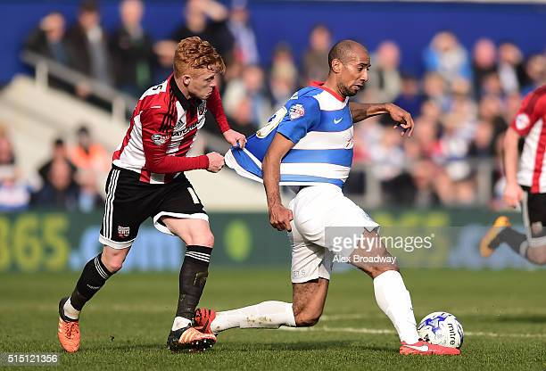 Karl Henry of Queens Park Rangers and Ryan Woods of Brentford contest the ball during the Sky Bet Championship match between Queens Park Rangers and...