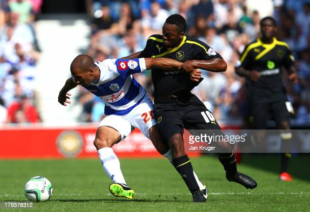 Karl Henry of Queens Park Rangers holds off Jacques Maghoma of Sheffield Wednesday during the Sky Bet Championship match between Queens Park Rangers...