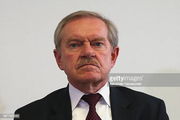 Karl Huber President of the Oberlandgericht Muenchen court looks on during a media conference following the lottery draw for the 50 media spots...