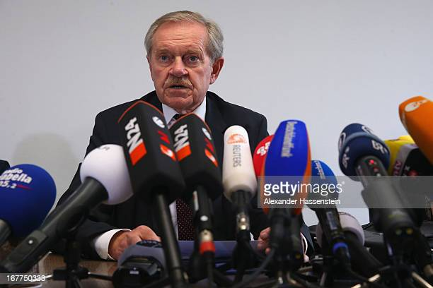 Karl Huber President of the Oberlandgericht Muenchen court speaks to the media following the lottery draw for the 50 media spots inside the courtroom...