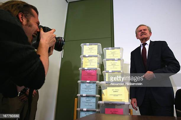 Karl Huber President of the Oberlandgericht Muenchen court stands next to the lottery boxes after a press conference following the lottery draw for...
