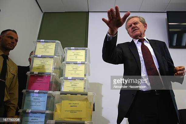 Karl Huber President of the Oberlandgericht Muenchen reacts after a press conference following the lottery draw for the 50 media spots inside the...