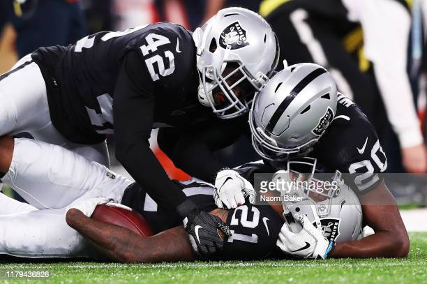 Karl Joseph of Oakland Raiders Daryl Worley of Oakland Raiders and Gareon Conley of Oakland Raiders celebrate after Gareon Conley intercepts the ball...