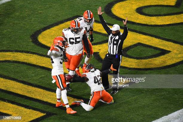 Karl Joseph of the Cleveland Browns celebrates a touchdown during the first half of the AFC Wild Card Playoff game against the Pittsburgh Steelers at...
