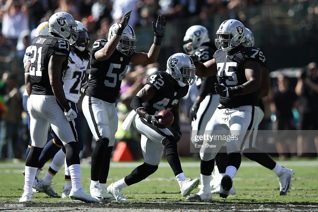 Karl Joseph #42 of the Oakland Raiders celebrates after intercepting a pass by Philip Rivers #17 of the San Diego Chargers during their NFL game at Oakland-Alameda County Coliseum on October 9, 2016 in Oakland, California.