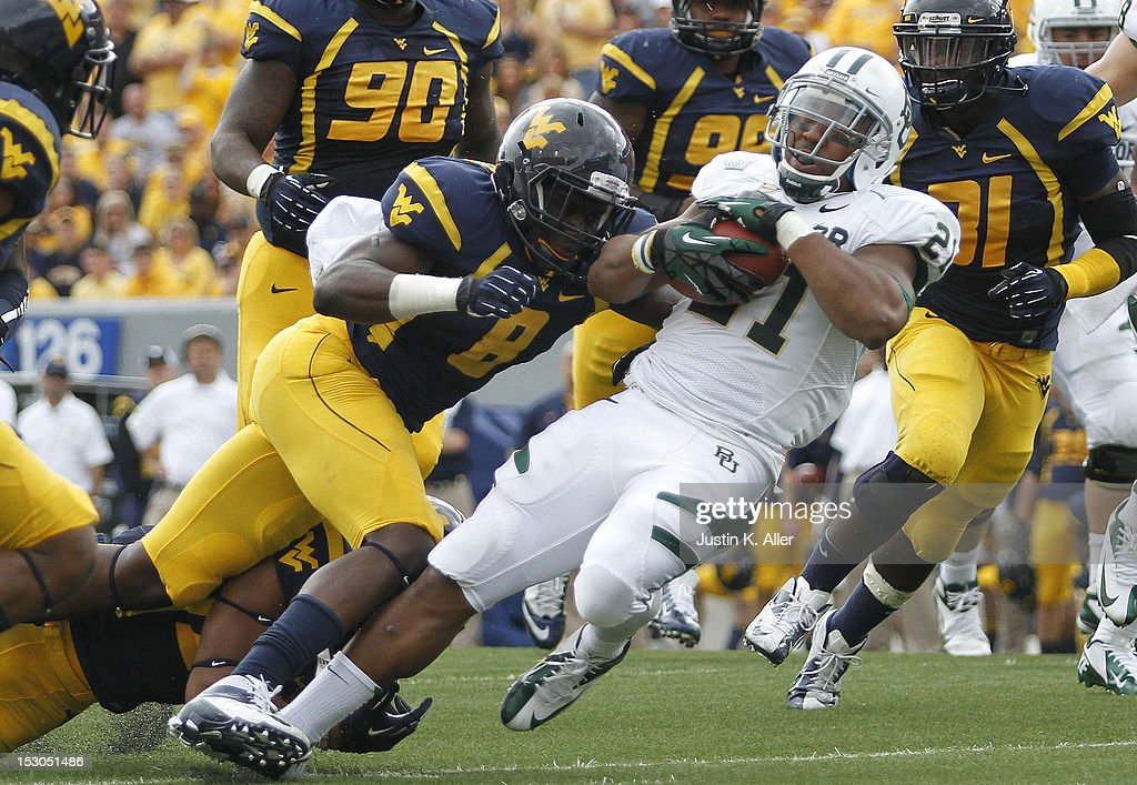 Karl Joseph #8 of the West Virginia Mountaineers tackles Jarred Salubi #21 of the Baylor Bears during the game on September 29, 2012 at Mountaineer Field in Morgantown, West Virginia. WVU defeated Baylor 70-63.