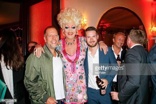 Karl Koenig alias Lotto King Karl Drag Queen Olivia Jones and Johannes Strate singer of the band 'Revolverheld' attend the 'Nacht der Legenden' at...