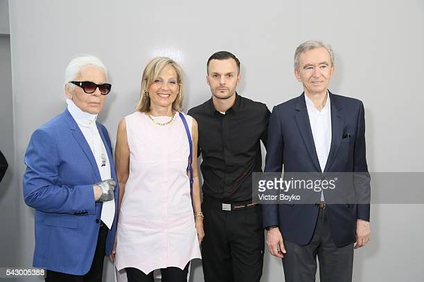 Karl Lagarfeld Helene Arnault Kris Van Assche and Bernard Arnault pose in the backstage before the Dior Homme Menswear Spring/Summer 2017 show as...