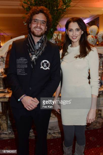 Karl Lagasse and Frederique Bel attend the Karl Lagasse At Mad Art Cocktail In Benefit of AMFE Children Care Association on November 13 2013 in Paris...