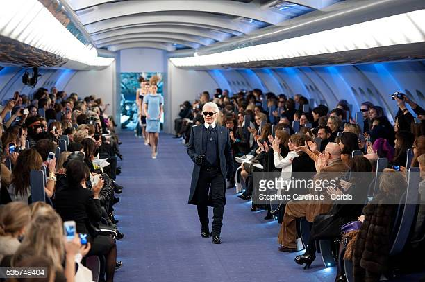 Karl Lagerfeld acknowledges the applause of the audience after the Chanel Haute Couture Spring/Summer 2012 show as part of the Paris Fashion Week...
