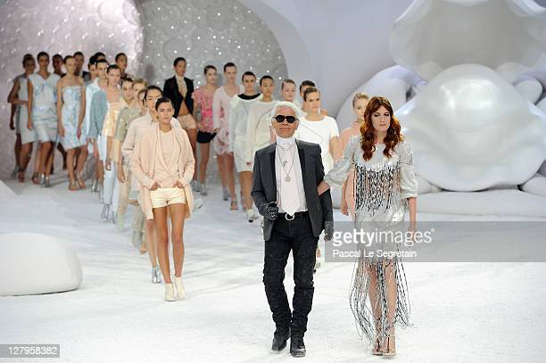 Karl Lagerfeld acknowledges the applause of the audience with models and Florence Welch of Florence and the Machine after the Chanel Ready to Wear...