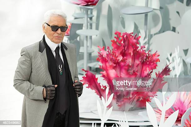Karl Lagerfeld acknowledges the audience during the Chanel show as part of Paris Fashion Week Haute Couture Spring/Summer 2015 at the Grand Palais on...