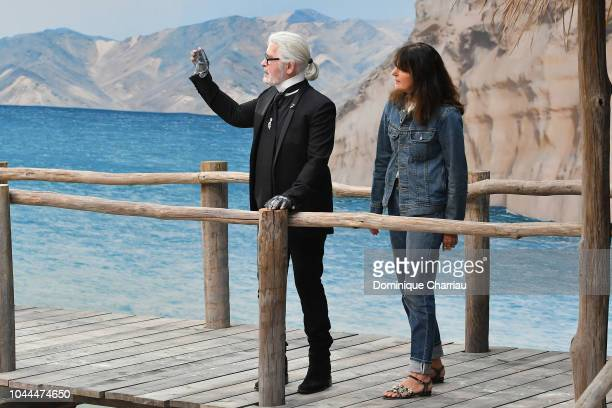 Karl Lagerfeld and a guest walk the runway during the Chanel show as part of the Paris Fashion Week Womenswear Spring/Summer 2019 on October 2 2018...