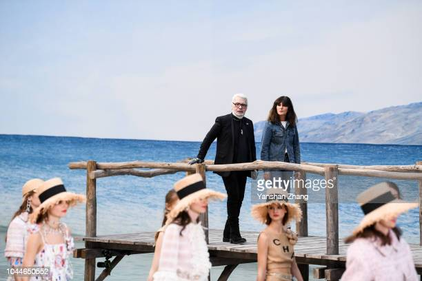 Karl Lagerfeld and a guest walk the runway during the Chanel showduring the Chanel show as part of the Paris Fashion Week Womenswear Spring/Summer...