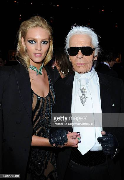 Karl Lagerfeld and Anja Rubik attend the 2012 amfAR's Cinema Against AIDS during the 65th Annual Cannes Film Festival at Hotel Du Cap on May 24 2012...
