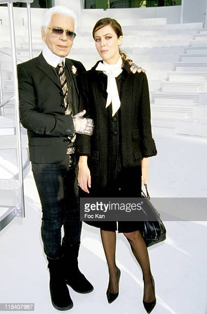 Karl Lagerfeld and Anna Mouglalis during Paris Fashion Week Haute Couture Spring Summer 2006 Chanel at Grand Palais in Paris France
