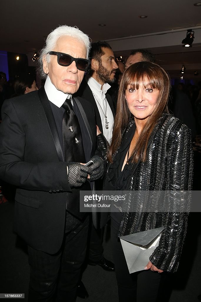 Karl Lagerfeld and Babeth Djian attend the Babeth Djian Hosts Dinner For Rwanda To The Benefit Of A.E.M. on December 6, 2012 in Paris, France.