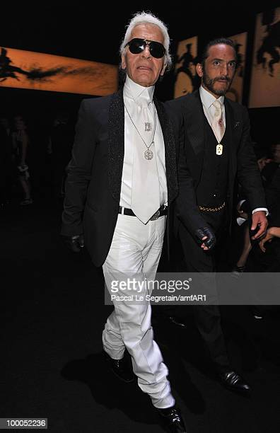Karl Lagerfeld and Brad Kroenig attend amfAR's Cinema Against AIDS 2010 benefit gala dinner at the Hotel du Cap on May 20 2010 in Antibes France