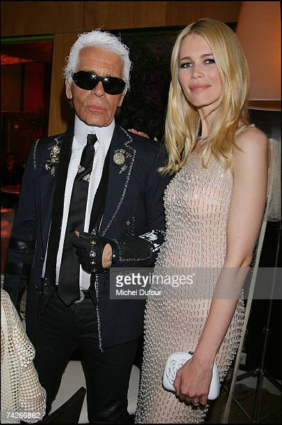 Karl Lagerfeld and Claudia Schiffer attend a dinner sponsored by magazine Madame Figaro to celebrate the Sixtieth Anniversary of the IFF on May 23...