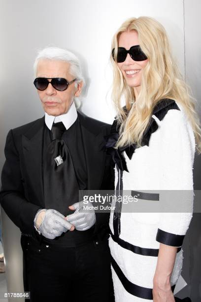 Karl Lagerfeld and Claudia Schiffer attend backstage at the Chanel Haute Couture Autumn Winter 2008 fashion show on July 1 2008 in Paris France