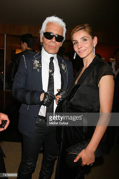 Karl Lagerfeld and Clotilde Coureau attend a dinner sponsored by magazine Madame Figaro to celebrate the Sixtieth Anniversary of the IFF on May 23...