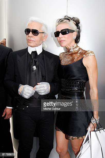 Karl Lagerfeld and Daphne Guinness attend backstage at the Chanel Haute Couture Autumn Winter 2008 fashion show on July 1 2008 in Paris France