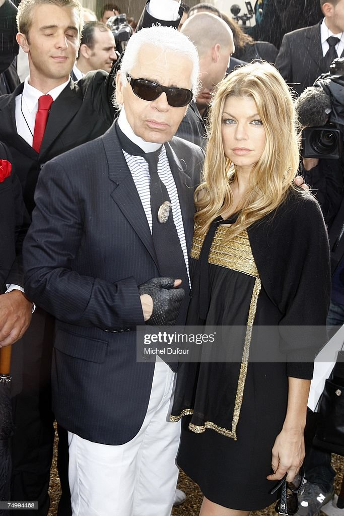 Karl Lagerfeld and Fergie attend the Chanel Fashion show, during Paris Fashion Week (Haute Couture) fall/winter 2008 at Parc de Saint Cloud on July 3, 2007 in Paris, France.