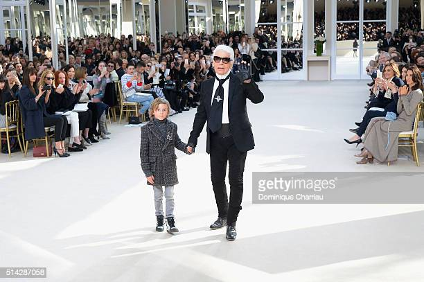 Karl Lagerfeld and his godson Hudson Kroenig pose on the runway during the Chanel show as part of the Paris Fashion Week Womenswear Fall/Winter...